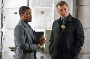 Detective Bell and Captain Gregson standing side by side in the morgue.