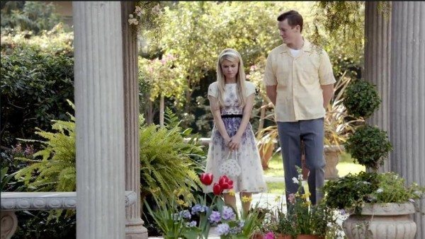 Carrie and Alex walking in a garden