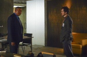 Two men stand about five feet apart facing each other.