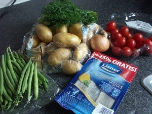 Potato salad ingredients: Potatoes, green beans, cherry tomatoes, onion, dill, herring in oil