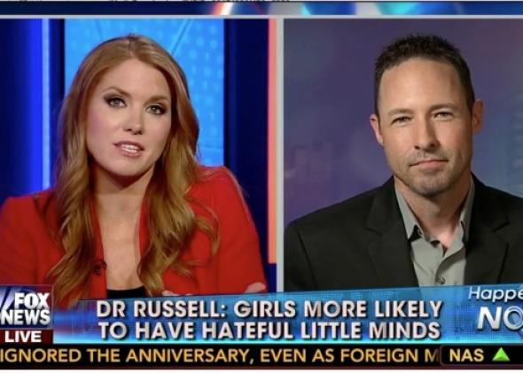 "Screengrab from Fox News in which the banner text at the bottom of the screen reads, ""Dr. Russell: Girls more likely to have hateful little minds."""