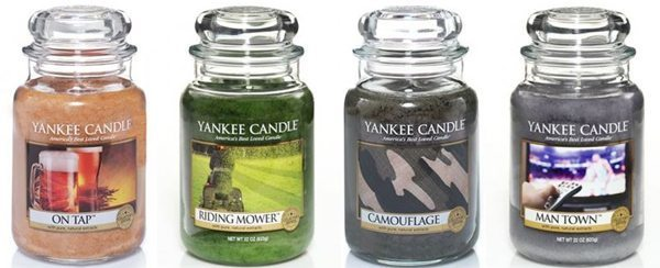 four candles from Yankee Candles in riding mower, man town, on tap, and camoflauge