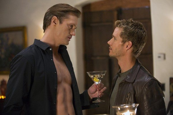 Eric wears his shirt open and offers a drink to Jason, in a seductive manner.