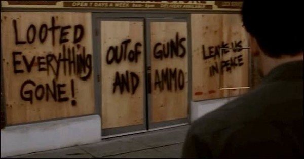 """Graffiti on the doors in St. Alice """"Out of guns and ammo"""""""