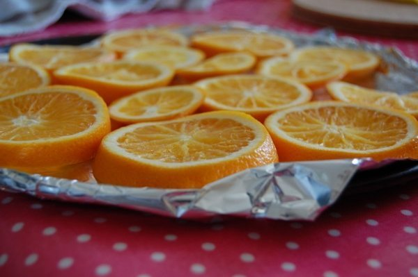 Orange slices, foil, oven