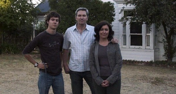 The family in front of their house.