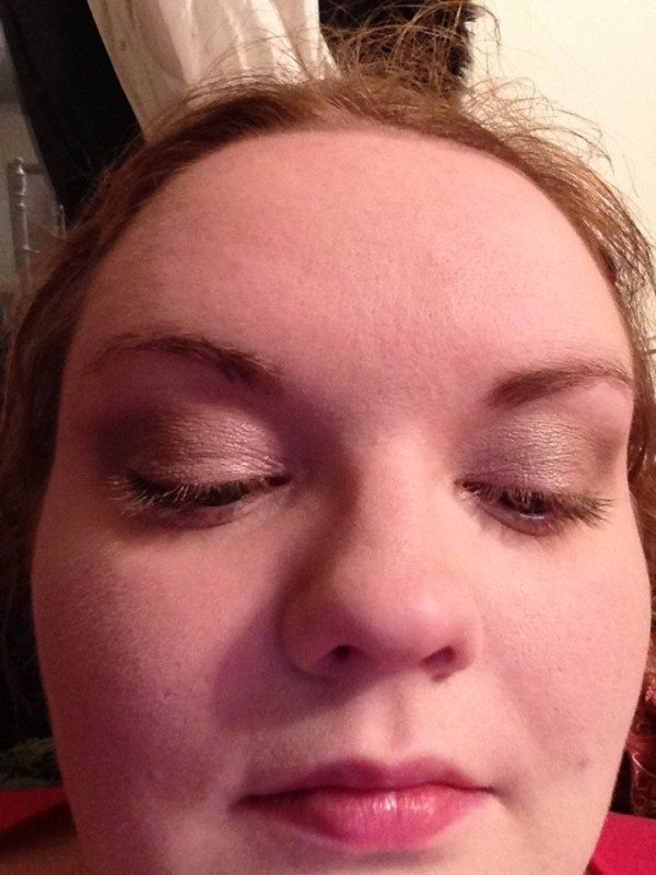 Eyes of a heavy pale person's eyes, closed with a base for eyeshadow on.