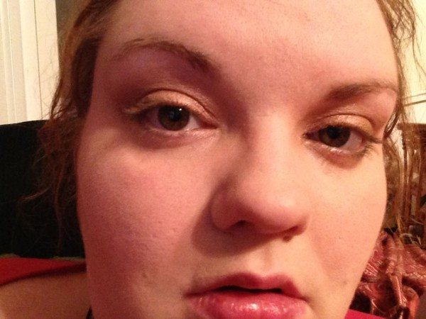 Heavy pale person's face, a medium sandy color across lids