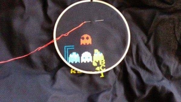 A picture of an in-progress cross-stitch project showing the Pac-Man kill screen.