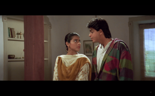 A screenshot of a man and woman looking into each other's eyes.
