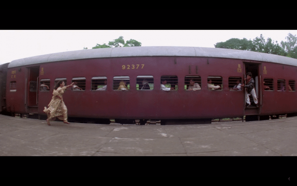 A woman runs after a train.
