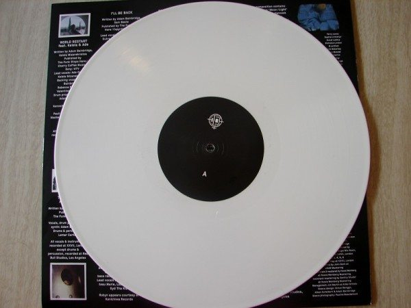 A picture of a white vinyl record laying on its case.