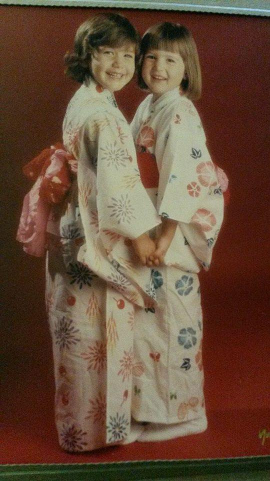 Two smiling young girls in kimonos