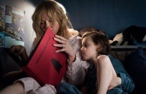 Amelia (Essie Davis) reads Mister Babadook to Sam (Noah Wiseman).