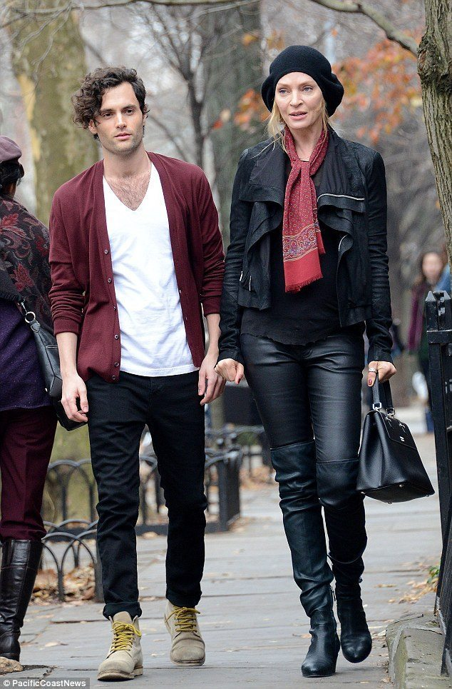 Dan from Gossip Girl has really let himself go. (An image of a brown-haired man walking with a blonde woman in a park.)