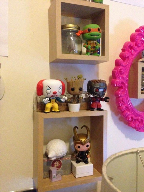 A picture of shelves displaying bobbleheads of Pennywise, Star Lord, Michaelangelo, Loki, and Groot.