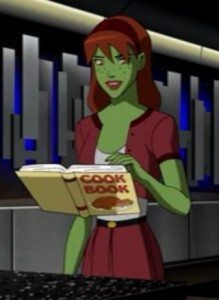 A picture of Miss Martian with a cookbook.