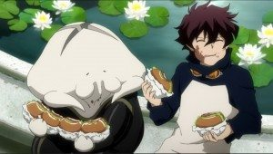 A picture of a young boy and a creature eating sandwiches.