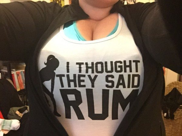 "Picture of a white tank top that says ""I thought they said rum"""