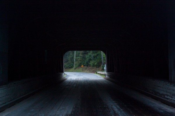A picture of the inside of a covered bridge.