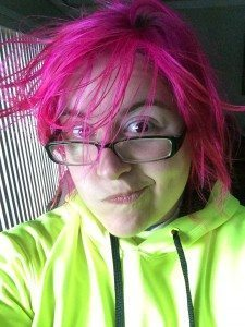 selfie of a woman with pink hair sticking out due to the effects of static electricity