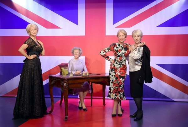 Helen Mirren poses with three wax figures of herself in Madame Tussads