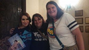 A picture of the author and her wife with Felicia Day.