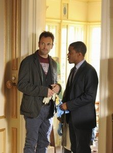 A picture of Sherlock Holmes and Detective Bell from Elementary.